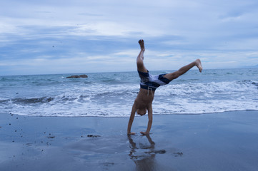 Boy to handstand on the beach