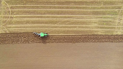 looking down at tractor plowing a field