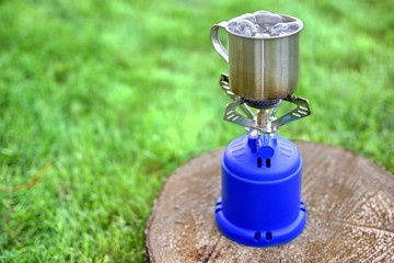 Camp Gas  Stove and steel tea mug.