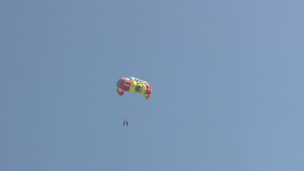Summer holiday scenics at the beach Parasailing and water sports