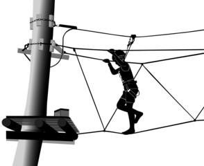 boy in adventure park rope ladder