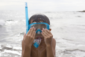 Boy wearing a snorkeling mask
