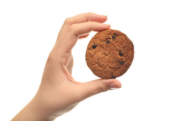 Oatmeal chocolate chip cookie in hand