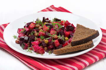 russian vegetable salad with beetroot - vinaigrette on a plate