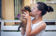 Portrait of pretty girl with a pekinese puppy