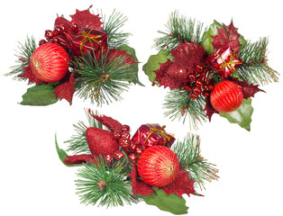 three isolated red and green christmas decorations