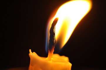 Close Up Candle With Creative Flame Over Dark Background (Noise