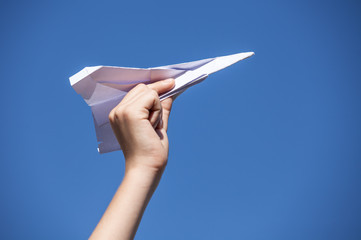 Paper airplane and blue sky