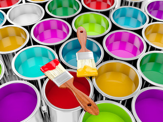 metal paint cans with colorful paint and paintbrush