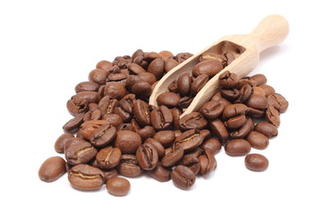 Heap of coffee on wooden spoon. White background