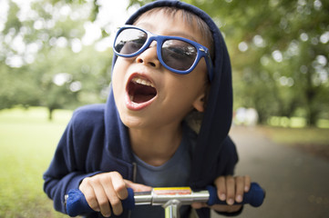 Boy riding a bike with shouting
