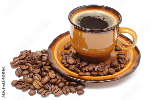 Heap of coffee grains and cup of beverage