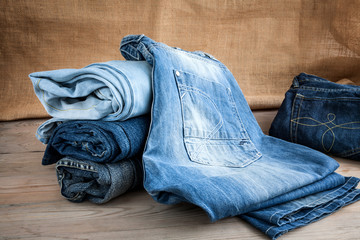 blue jeans on wooden table