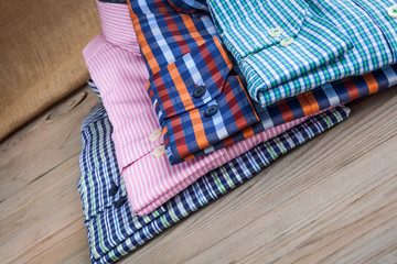 Men's shirts on wooden table