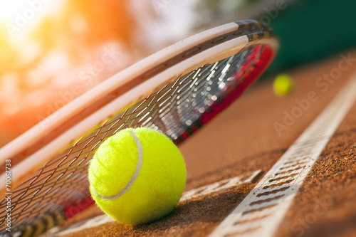 Poster tennis ball on a tennis court