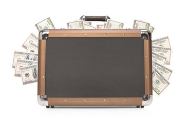 Studio shot of a briefcase full of cash
