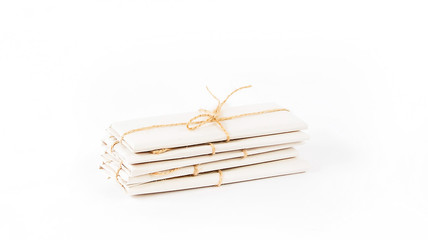 packages wrapped with brown kraft paper and tied with twine isol