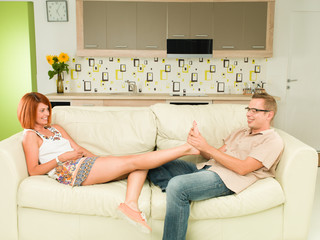 couple relaxing at home on sofa