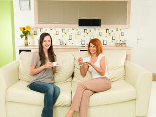 women having fun while drinking coffee