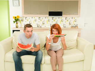 couple eating delicious watermelon