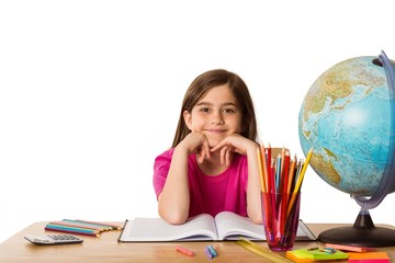 Cute pupil working at her desk