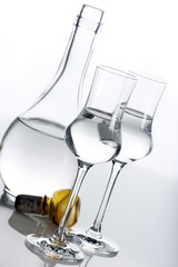 Clear spirit in carafe and glasses