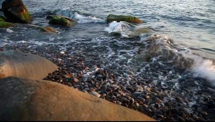 Sea waves on the shingle beach