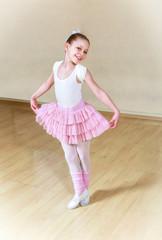 happy small ballerina at dancing school