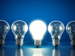 canvas print picture - One lit bulb among unlit ones