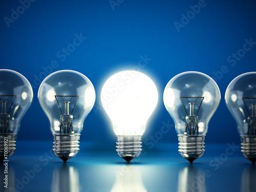 canvas print picture One lit bulb among unlit ones