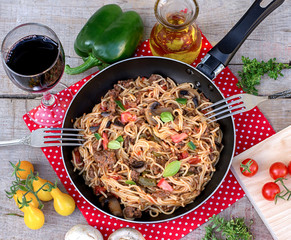 Vegetables, beef and noodles skillet with mushrooms