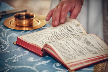 church utensil and bible on an alta