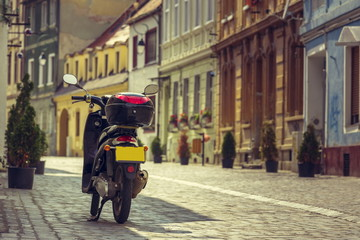 Scooter parked on alley in Brasov city, Romania