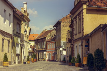 Medieval houses and promenade alley in Brasov city, Romania