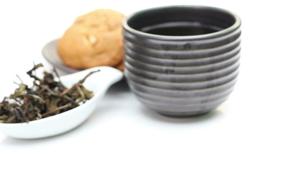 Loose Tea And Cup Of Tea, Rotation Of Tea on white background
