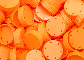 orange lid of plastic bottles talcum powder