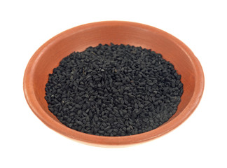 Small bowl of black caraway seeds