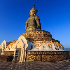 be behind crowned buddha image