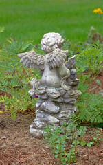 Back of a small garden cherubim with wings