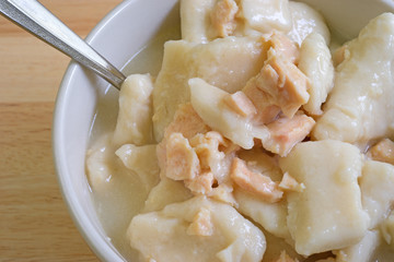 Close view of chicken and dumplings in bowl