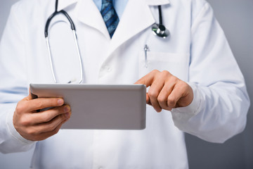 Male doctor with tablet computer