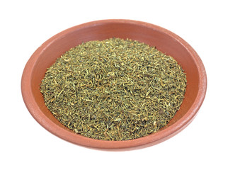 Dill weed in a small bowl