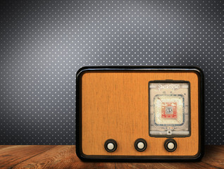 Old retro radio on wooden table on blue background Wallpaper