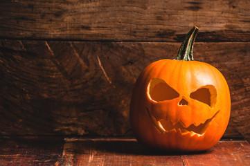 Halloween pumpkin on wooden rustic background
