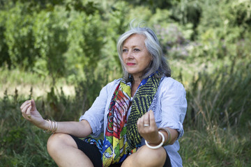 Mature woman meditating