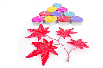 Colorful christmas decoration with different candles on backgrou