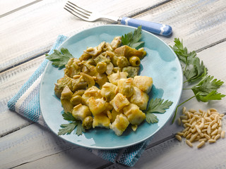 stewed fish with artichoke olives and pine nuts