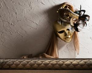 Venetian masks on  old wall