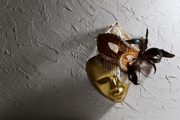 Venetian masks on  old wall
