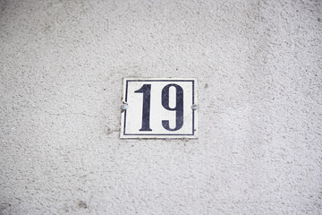 Number nineteen in the wall of a house